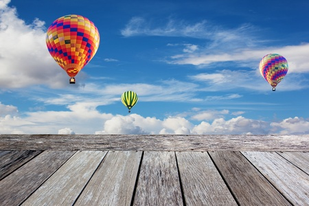 balloon and Wooden balcony in the blue sky background photo