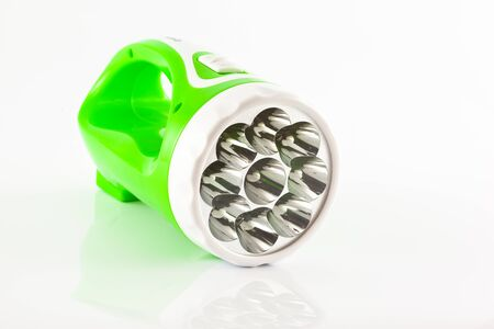 Green flashlight on white background photo