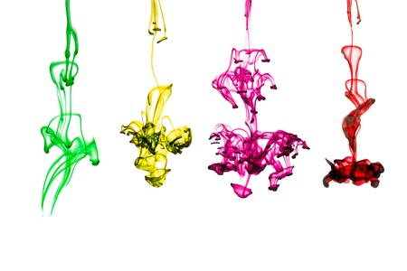 ink colors flowing in water  on white background photo