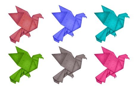 paper birds on white background photo