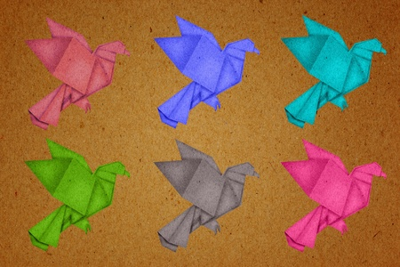 paper birds on brown paper background photo