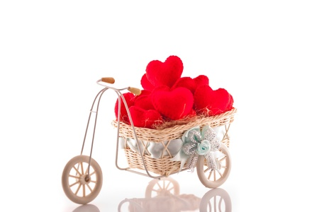 Bicycle with red heart on white background photo