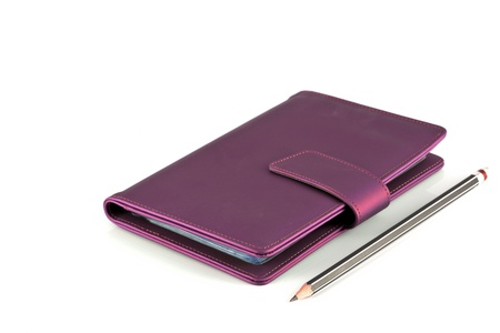leather note book on white background photo