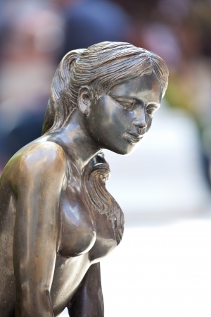 close up statue of a woman made from metal photo