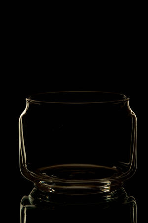 Glass jar on dark background photo