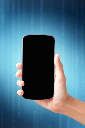 women hand  touch smart phone on dark blue background photo