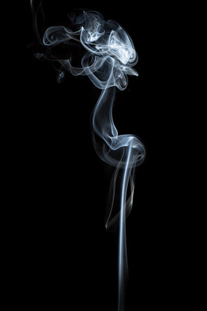 Abstract smoke isolated on dark background Imagens