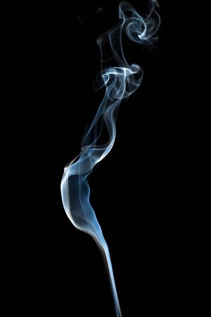 cigarette smoke: Abstract smoke isolated on dark background Stock Photo