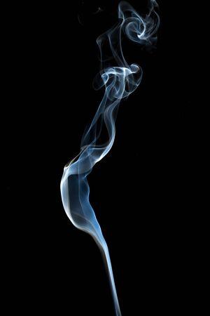 white smoke: Abstract smoke isolated on dark background Stock Photo