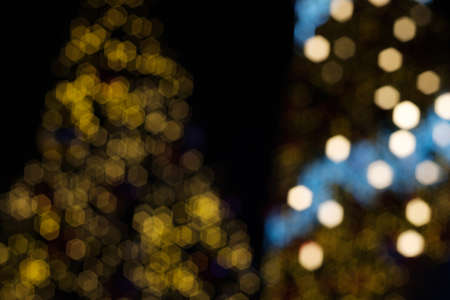 Decorated Christmas tree with bokeh light sparkling in the night