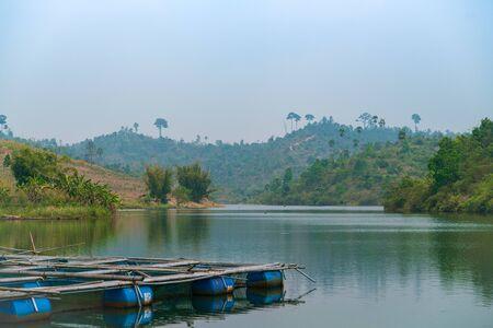Wooden raft in the lake Фото со стока