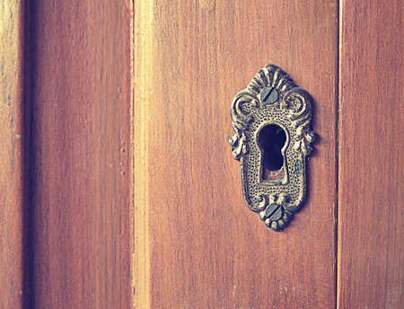 antique keyhole: Old rusty keyhole on antique furniture vintage effect and noise are added