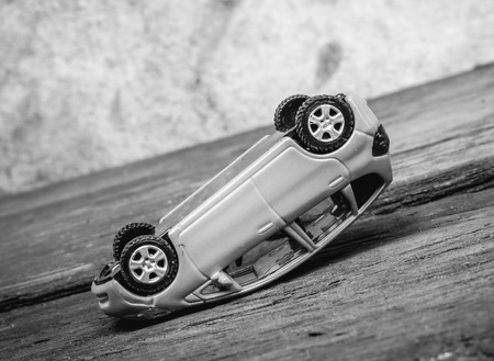 rollover: Rollover toy car at steep slope, black and white effect (selective focus) Stock Photo