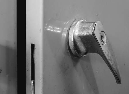 lock and key: Old and rusty handle with key hole of steel cabinet, black and white effect Stock Photo