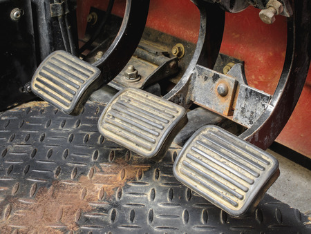 accelerator: Dirty brake, clutch, and accelerator gear shifter pedal of manual transmission car