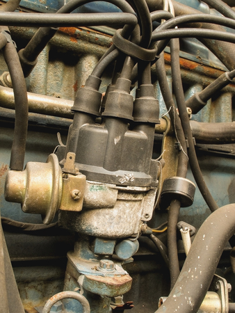 distributor: Old car distributor with spark plug wire is attached to the eng