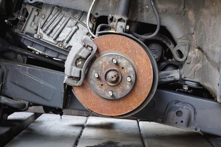 brake caliper: Old and rusty car disc brake and caliper