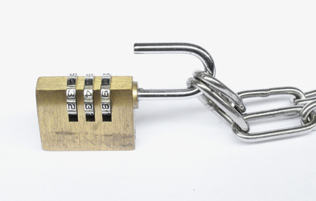 dial lock: Old golden three dial digit number combination lock with chain links, selective focus