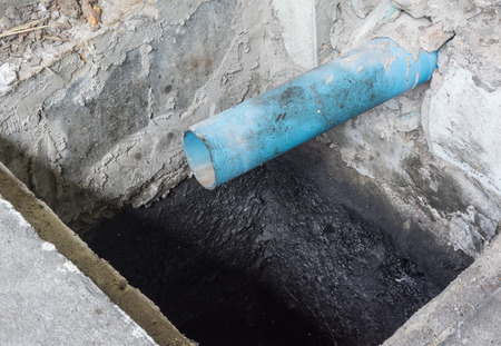 dredging: Blue PVC water pipe in dirty underground sewer for dredging drain tunnel cleaning, selective focus