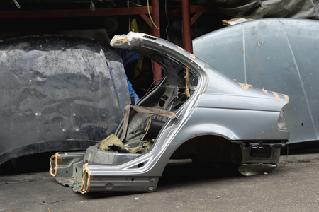 second hand: Gas cut used car body for using as second hand spare parts in garage