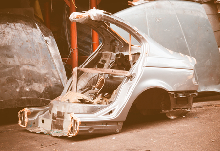 body parts: Gas cut used car body for using as second hand spare parts in garage, vintage effect