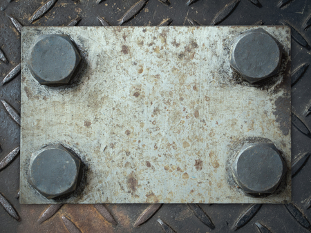 checker plate: Old and rusty grunge metal plate with rivets on checker plate background Stock Photo