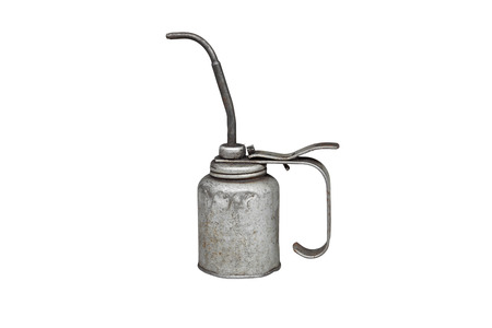 Old and dirty metal oil can, isolated on white background