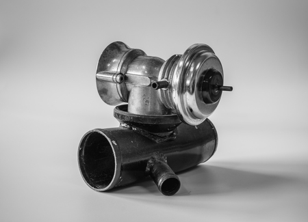 Old blow off valve for modify car performance and styling on white background with color filter effect and noise grain added Stock Photo