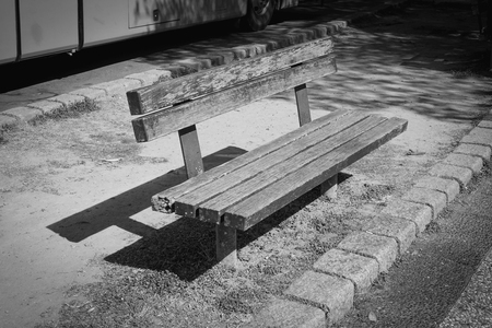 Empty old wooden bench in park with color filter effect