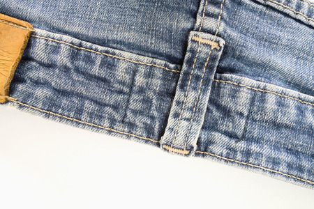 Old fashion blue jeans on white background