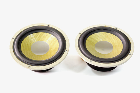 Pair of yellow old car audio speaker on white background