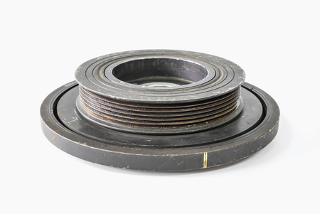 Old used car engine pulley o white background Stock Photo