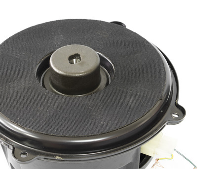 Part of black old car audio subwoofer on white background