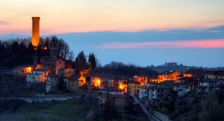 A small village in Italy. Night falls on Castellino Tanaro, in the Langhe, Piedmont. Behind him is Rocca Ciglià©, with its high illuminated tower.