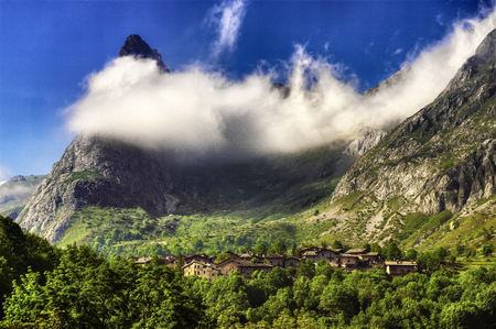 The village of Chiappera, in the upper Maira Valley in Piedmont, partially wrapped from the clouds.