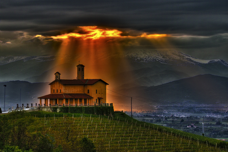 Bastia Mondovi ', the Langhe, Piedmont, Italy. A beam of light through the stormy clouds.