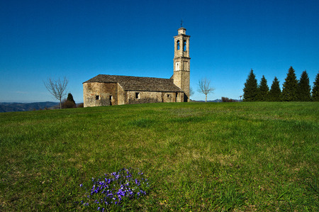 The sanctuary of the Madonna del Carmine of Prunetto, in the Langhe, probably built in the fourteenth century in the local sandstone near the castle. Editorial
