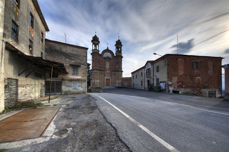 Langhe, Surie of Clavesna, a gosth town in Italy. - Surie of Clavesana where you can still see the signs of a bar, a restaurant and a mechanic workshop completely abandoned. 스톡 콘텐츠