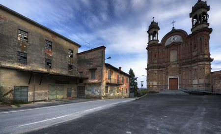Langhe, Surie of Clavesna, a gosth town in Italy. - Surie of Clavesana where you can still see the signs of a bar, a restaurant and a mechanic workshop completely abandoned. Banco de Imagens