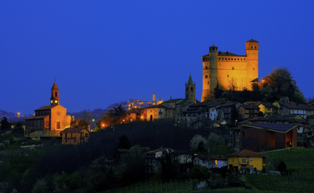 Night view of Serralunga d'Alba. In the background, over 15 km away, you can see the village of Murazzano with its high medieval watchtower.