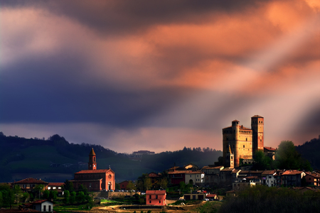 Serralunga d'Alba under a stormy sky. We are at the center of the