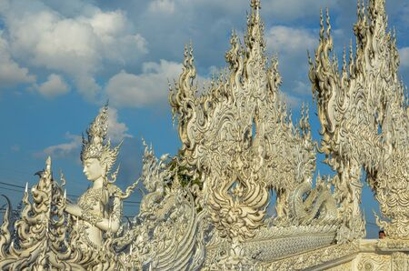 faerie: An angle sculpture in Thailand on the blue sky day Stock Photo
