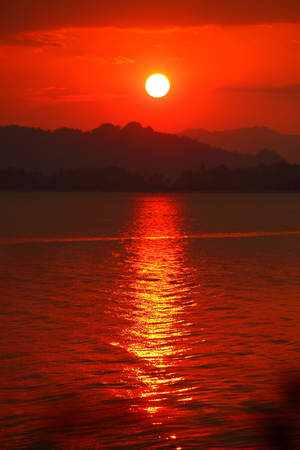 sunrise beach: Sunset and red sky over mountain,Reflex on River  Stock Photo