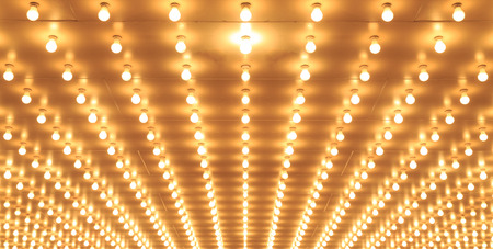 Old style theater marquee lights walkway to the theater  Aligned theater lights of Chicago Theater  Casino lights photo