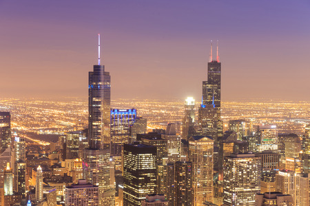 City of Chicago  Aerial view of Chicago downtown at nigh from high above  photo