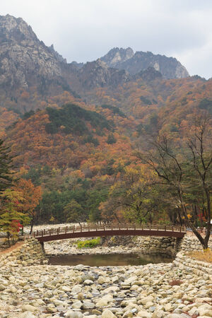 public offering: River with white stone river bed at Seoraksan national park during autumn season