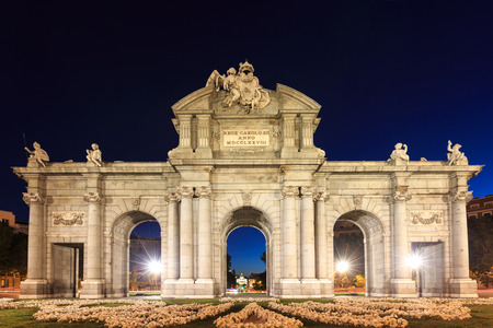 The Puerta de Alcala is a monument in the Plaza de la Independencia in Madrid, Spain. photo