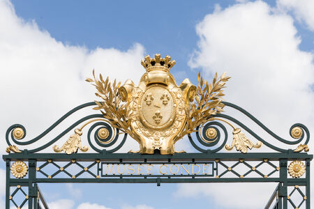 conde: CHANTILLY, FRANCE JUNE 19, 2014:view of decoration of the gate in Chantilly castle of France on June 19, 2014. It is a historic castle located in the town of Chantilly. It houses the Museum of Conde Editorial