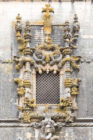 The most famous window in manuelino-style, Christ Convent cloister, Tomar, Portugal.