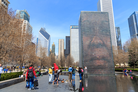 plensa: CHICAGO, USA - APRIL 18 : View of the Crown Fountain in Millennium Park in Chicago on April 18 2014 ,The fountain is interactive work of public art and video sculpture designed by Jaume Plensa.